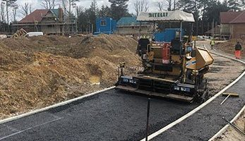 Tarmacking using machinery at new build site by Whittaker Surfacing